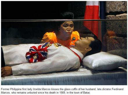 Imelda-Marcos-looks-the-glass-coffin-of-Ferdinand-Marcos.jpg